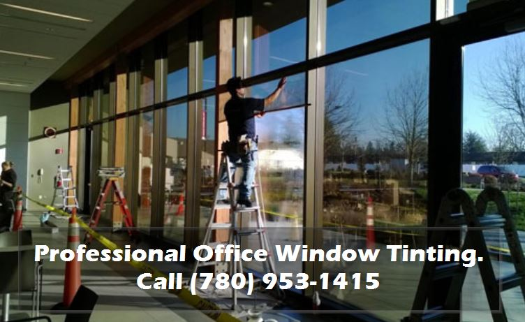 Guy tinting office windows